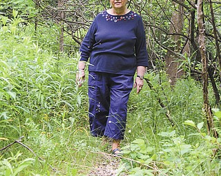 Barbara Tesyk, a 1957 graduate of Struthers High School and the city's deputy tax clerk, walks along a small portion of what used to be Struthers Municipal Pool in Yellow Creek Park.