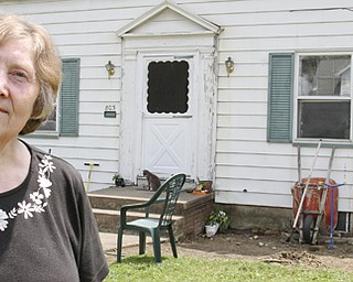 William d Lewis The Vindicator Linda Riley stands in front of her Idora neighborhood home.Her husband Jerry Riley is housebound.  They are having a fundraiser to help with cost of building a wheelchair ramp.