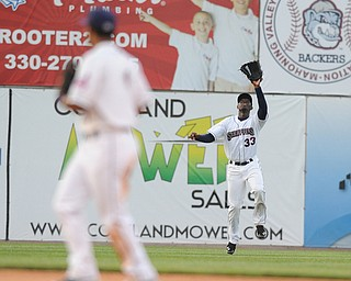 NILES, OHIO - JUNE 17, 2014: Outfielder Jorge Martinez #33 of the Scrappers peps to catch a fly ball for the 3rd out in the top of the 5th inning during Tuesday nights New York Penn League game at Eastwood Field. (Photo by David Dermer/Youngstown Vindicator) Infielder Ordomar Valdez pictured.