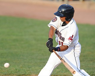 NILES, OHIO - JUNE 17, 2014: Batter Ordomar Valdez #11 of the Scrappers swings before making contact with a pitch he would drive to the outfield for a double in the bottom of the 3rd inning during Tuesday nights New York Penn League game at Eastwood Field. (Photo by David Dermer/Youngstown Vindicator)