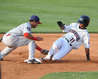 NILES, OHIO - JUNE 17, 2014: Base runner Ordomar Valdez #11 of the Scrappers slides into second base for a double beating the tag of infielder Bryan Mejia #1 of the Doubledays in the bottom of the 3rd inning during Tuesday nights New York Penn League game at Eastwood Field. (Photo by David Dermer/Youngstown Vindicator)