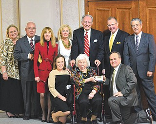 SPECIAL TO THE VINDICATOR Jeanne D. Tyler donated a half-million dollars to Stambaugh Auditorium, which has prompted the Grand Ballroom to be renamed the Tyler Grand Ballroom. A dinner in her honor took place May 7, and some of those present follow. In front, from left, are Margaret Adams, Tyler, and Mark Gasser. In the back are Susan Berny, Jim Sisek, Suzyn Schwebel-Epstein, Jeanne Simeone, William Conti, Terrence Cloonan and J. David Sabine.