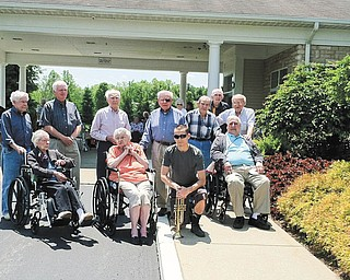 SPECIAL TO THE VINDICATOR Whispering Pines honored veterans during a ceremony on Memorial Day. Veterans, in front from left, are Evelyn Dodson; Ruth Wagenhouser; Devin Wilson, Leetonia High School graduate; and Robert Dietz. In back are Davis Huffman, Jim Winters, Paul Vrable, Rolin Herron, Mike Petro, Harry Neiheisel and Ernie Bernard.
