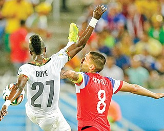 Ghana's John Boye, left, challenges the United States' Clint Dempsey for the ball during Monday's World Cup match in Natal. USA won, 2-1.