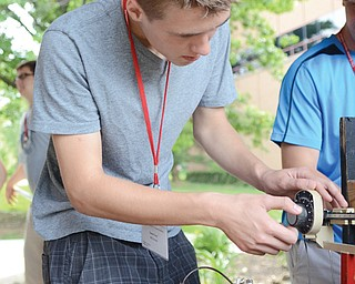 David Irwin, 17, of McDonald measures a potato before placing it in the cannon.