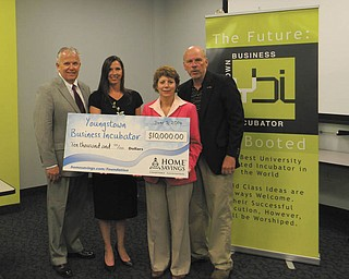 SPECIAL TO THE VINDICATOR Home Savings Charitable Foundation has donated $10,000 to the Youngstown Business Incubator. From left are Richard Schiraldi, chairman of the board, UCFC; Pamela Kimmel, director, Home Savings Charitable Foundation; Barb Ewing, COO, YBI; and James Cossler, CEO and chief evangelist, YBI.