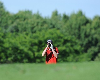 HERMITAGE, PENNSYLVANIA - JUNE 20, 2014: Zach Jacobson of Poland uses his range finder to find the distance to the green from the fairway on the 5th hole Friday morning at Tam O'Shanter golf course during the Vindy Greatest Golfer tournament. (Photo by David Dermer/Youngstown Vindicator)