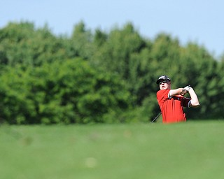 HERMITAGE, PENNSYLVANIA - JUNE 20, 2014: Zach Jacobson of Poland follows through with his shot after shooting from the fairway to the green on the 5th hole Friday morning at Tam O'Shanter golf course during the Vindy Greatest Golfer tournament. (Photo by David Dermer/Youngstown Vindicator)