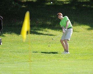 HERMITAGE, PENNSYLVANIA - JUNE 20, 2014: Tavish Brude of Warren chips out of the short rough and toward the green on the 17th hole Friday morning at Tam O'Shanter golf course during the Vindy Greatest Golfer tournament. (Photo by David Dermer/Youngstown Vindicator)
