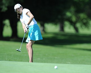 HERMITAGE, PENNSYLVANIA - JUNE 20, 2014: Hadley Spielvogel of Boardman follows through on her putt as the ball breaks toward the hole on the 13th hole Friday morning at Tam O'Shanter golf course during the Vindy Greatest Golfer tournament. (Photo by David Dermer/Youngstown Vindicator)