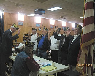 SPECIAL TO THE VINDICATOR: American Legion Post 737 intalled officers for 2014-2015 at its June 5 meeting. Facing left, from left, are Joe Leonard, treasurer; Bill Cameron, adjunct; Bud Bittinger, second vice president; Bob Hughes, first vice president; and James Boehmer, commander. Standing and facing the officers is Gary Mellows, past district commander, who did the swearing in. Sitting and observing was George Street III, chaplain. A meal was served after the meeting.