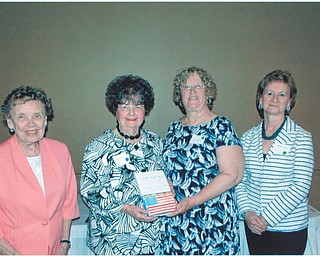 """SPECIAL TO THE VINDICATOR: The Mahoning Retired Teachers Association recently gathered for its annual In Memoriam program at Antone's Banquet Centre. Members honored all deceased Mahoning County public educators for the 2013-2014 membership year. """"The Unwinding,"""" a book by George Parker, was purchased by the John M. Knapick Memorial for deceased members and will become part of the collection at the Public Library of Youngstown and Mahoning County. Some of those who participated in the program, from left, are Mary Jane Lewis, historian; Sally Knapick Winsen, In Memoriam chairwoman; Linda Vuletich, MRTA president; and Martha Lopez, Remembrance chairwoman."""