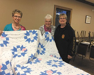 SPECIAL TO THE VINDICATOR: Ginger Mangie, left, president of That Quilt Group I Belong To of Canfield, recently presented a memory quilt to Julie Maruskin, center, recently retired owner of Quilter's Quarters in Boardman. The quilt was made by Bev Sullivan, right, in honor of Maruskin's 25 years in the quilting business.