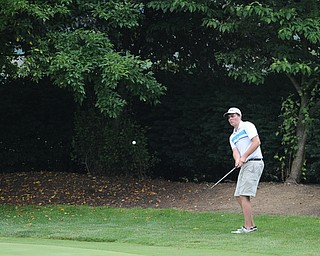 SALEM, OHIO - JUNE 23, 2014: Ethan Grim of Western Reserve chips his ball onto the green on the 17th hole on Monday afternoon at the Salem Golf Club during the Vindy Greatest Golfer tournament. (Photo by David Dermer/Youngstown Vindicator)