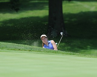 SALEM, OHIO - JUNE 23, 2014: Rachel Russell of Howland chips out of the bunker and onto the green Monday afternoon at the Salem Golf Club during the Vindy Greatest Golfer tournament. (Photo by David Dermer/Youngstown Vindicator)