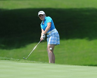 SALEM, OHIO - JUNE 23, 2014: Kaci Carpenter on Canfield chips onto the green from the short rough on Monday afternoon at the Salem Golf Club during the Vindy Greatest Golfer tournament. (Photo by David Dermer/Youngstown Vindicator)