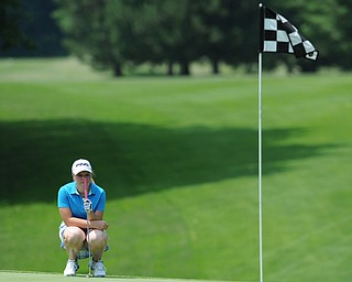 SALEM, OHIO - JUNE 23, 2014: Kaci Carpenter on Canfield lines up her shot on the green on Monday afternoon at the Salem Golf Club during the Vindy Greatest Golfer tournament. (Photo by David Dermer/Youngstown Vindicator)