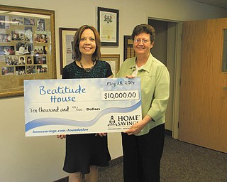 SPECIAL TO THE VINDICATOR Sister Janet Gardner, right, executive director of the Beatitude House, recently accepted a $10,000 gift from Home Savings Charitable Foundation's main branch manager, Trish Mohan. Beatitude House plans to use the funds for its transitional housing program for homeless women. For information about Beatitude House call 330-744-3147 or visit beatitudehouse.com.