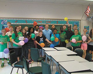 SPECIAL TO THE VINDICATOR The junior high students at St. Patrick School in Hubbard recently surprised social studies teacher Matt Green, center, with a wedding shower in honor of his upcoming nuptials. A buffet lunch and cake were enjoyed by the students and Green, and students presented him with gift cards.