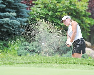 Nicolette Eddy of Kennedy chips out of the bunker on the 12th hole at Salem Golf Club during Monday's Greatest Juniors qualifier. It was a difficult afternoon for Eddy and most of the golfers, but four more juniors earned a spot in the championship on July 27 at Avalon Lakes Golf Club.