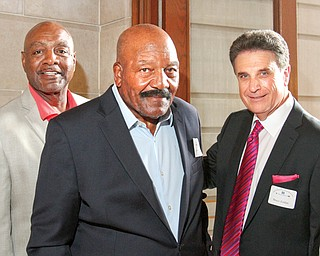 From left, former Cleveland Browns Reggie Rucker and Jim Brown attended the Edward J. DeBartolo Memorial Scholarship Foundation's dinner with Phantoms Fireworks CEO Bruce Zoldan at Stambaugh Auditorium.
