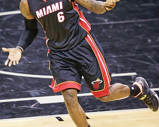 LeBron James could be taking his talents somewhere other than South Beach after his agent on Monday informed the Heat that the four-time MVP will opt out of his contract, leaving his future with the team in question. On Tuesday, James told the media he and his family are going on vacation before making any decisions. James would become a restricted free agent July 1.