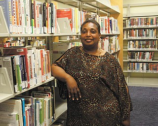 Candy Peace-Tarpley is working on gathering history of the black community in Youngstown. ROBERT K. YOSAY    THE VINDICATOR.