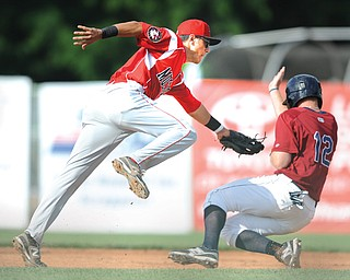 Muckdogs infielder Aaron Blanton attempts to tag Scrappers' Austin Fisher during a steal attempt in second inning of Game 1 of their doubleheader Wednesday at Eastwood Field in Niles. The Scrappers won the early game, 5-0, but lost the nightcap, 4-1.