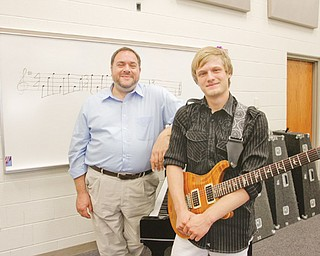 For his senior capstone project, 18-year-old Nick Frank, who graduated from Lowellville High School earlier this month, composed a piece of music that was performed by his school's concert band. With him is Bob Antonucci, Lowellville's band teacher and a mentor for Frank's project.