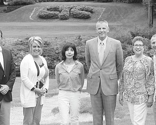 """ROBERT K. YOSAY   THE VINDICATOR:  The Hope House Visitation Center of Youngstown has planned a fundraiser in the form of a golf outing, to take place Aug. 15 at the Youngstown Country Club. Ray """"Boom Boom"""" Mancini will be the celebrity golfer. From left to right are A.J. Turner, Maria Meadors, Denise DeBartolo York, Matt Taylor, Carole Bopp and Mancini."""
