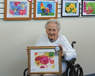 SPECIAL TO THE VINDICATOR Helen Lucas, 100, of Austintown,  above, won a Juror's Choice Award. Winning an award for Creativity was Janet Freisen of Austintown, at left.