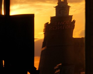 William D. Lewis The Vindicator The Home Savings building is reflected in a window of the PNC building at sunset in downtown Youngstown.