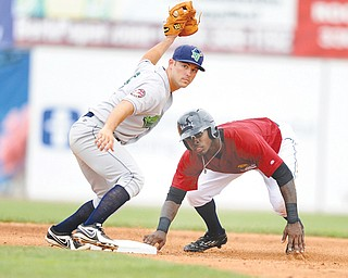 Jamestown infielder Erik Lunde shows the ball to the umpire after tagging out Scrappers baserunner D'Vone McClure during Sunday's New York-Penn League game at Eastwood Field.