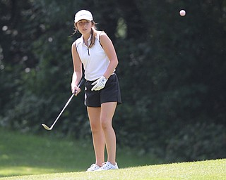 CANFIELD, OHIO - JUNE 30, 2014: Kara Seeco of Boardman chips her ball from the fairway to the green on the 8th hole Monday morning at Diamondback Golf Course during the Vindy Greatest Golfer of the Valley tournament. (Photo by David Dermer/Youngstown Vindicator)