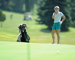 CANFIELD, OHIO - JUNE 30, 2014: Cait Butler of Canfield reacts after watching her long putt fall shot of the hole on the 7th hole Monday morning at Diamondback Golf Course during the Vindy Greatest Golfer of the Valley tournament. (Photo by David Dermer/Youngstown Vindicator)