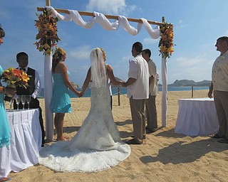 Wendy Fisher sent this of her special day, Aug. 9, 2013, in Cabo San Lucas, Mexico. The minister had them all hold hands and he blessed them as a family, from left to right, Melissa Bayus of Columbus, maid of honor; Allie Baklarz, Wendy's daughter; the bride; her husband, Jaison Fisher;  the bride's son, Krystopher Baklarz, all of Boardman; and the best man and groom's brother, Jeff Fisher of Uniontown, Pa.