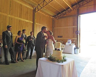 Mr. and Mrs. Luke Rust sharing a kiss at their reception.