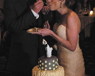 Dr. and Mrs. Vincent Peyko are enjoying a piece of custom lemon cake made by the best man and Vincent's brother, John Peyko, owner of D.B.C, a Cakery, of Boardman. Sent by John.