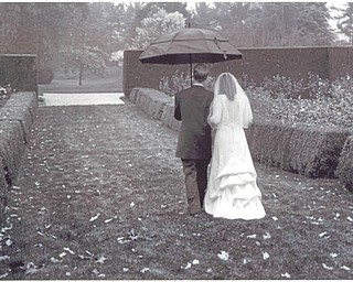 Jim and Lynda Markos, Oct. 9, 2009, their wedding day, as they leave the Rose Garden in Mill Creek Park. Sent by Margie Goldner, Lynda's Mom who loves that it looks like the photo could have been taken 100 years ago.