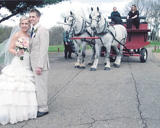 The former Natalie Swingler and her new hubby, Steven Holden, on their wedding day, May 3. It had been a dreary day, and then the sun appeared just as the ceremony was about to start. Sent by great-aunt Mary Lou Korenich.