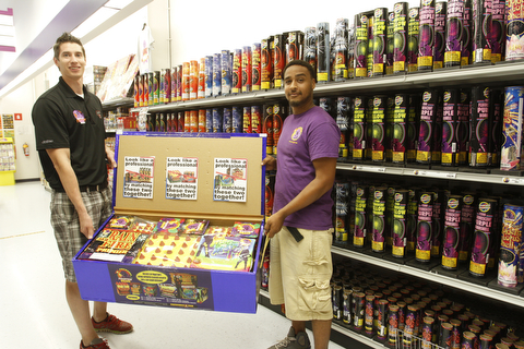 Phantom Fireworks assistant manager Dave Phelan and Chris Gibboney hold the 'Strong Box' of fireworks available for the quick shopper.