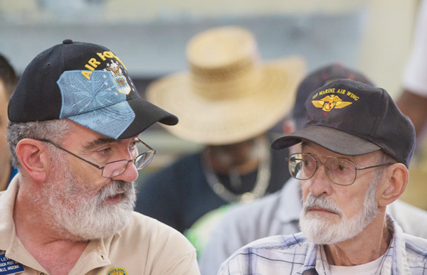 Vietnam veteran Gene Stoesser, right, talks with Veterans Crisis Command Center volunteer Chuck Lewi while he waits for an appointment at American Legion Post 1 in Phoenix.
