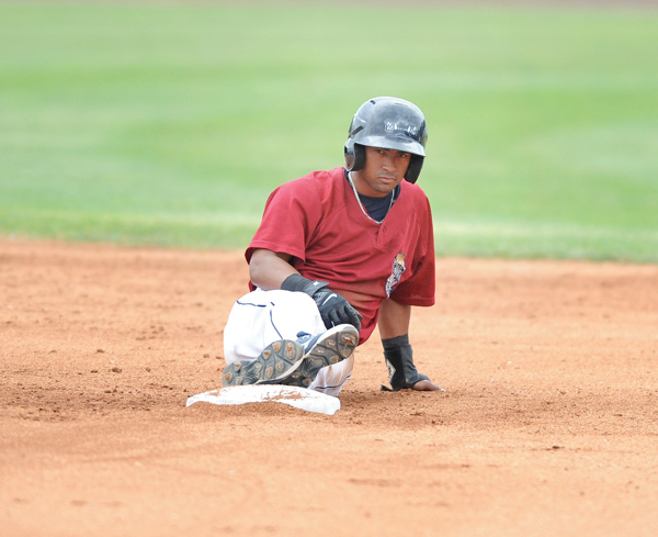 Scrappers baserunner Ordomar Valdez sits at second base for a moment after being tagged out in a rundown to end the fifth inning of Sunday's New York-Penn League game against the Batavia Muckdogs at Eastwood Field in Niles. The Muckdogs downed the Scrappers, 5-3, and swept the series, 3-0.