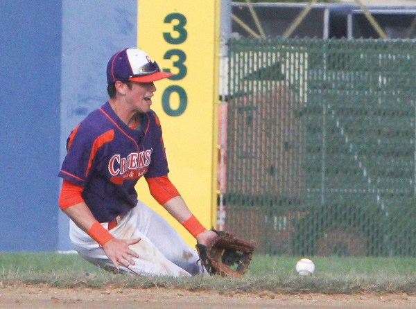 Ted Williams of Creekside makes a sliding stop down the right-field line during a Class B 18-under-under game against the Ohio Glaciers on Tuesday night at Bob Cene Park in Struthers. Creekside won the first game, 10-2.