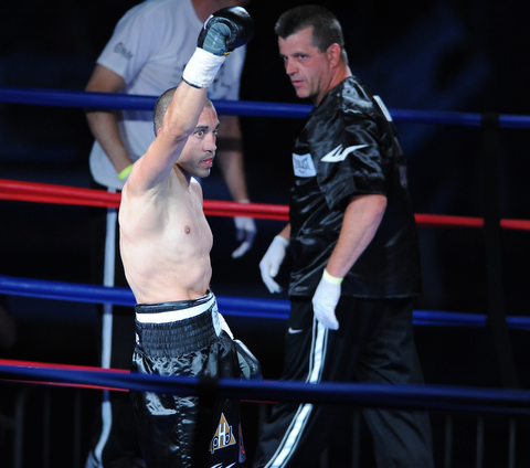 PITTSBURGH, PENNSYLVANIA - JULY 11, 2014: Jake Giuriceo celebrates in the center of the ring, while thanking his fans after a referee stoppage after a welterweight bout Friday night at Rivers Casino. Giuriceo would win via 4th round TKO. (Photo by David Dermer/Youngstown Vindicator) Trainer Keith Burnside pictured.