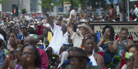 Katie Rickman | The Vindicator.The crowd cheers as Kim Waters finishes his song Red Wine and You at the Jazz Festival downtown July 12, 2014.