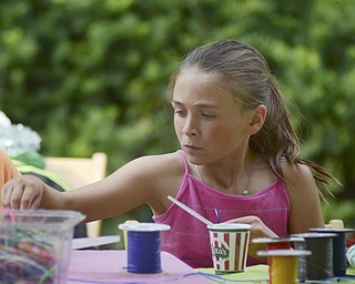 Katie Rickman | The Vindicator.Elly Wright, 8, of Niles does crafts at the hands-on art tent at the 16th annual festival. The eventalso features an artistsÕ marketplace, which this year showcased the works of 77 regional and national artists.