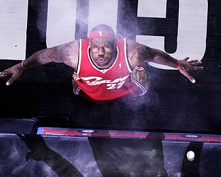 Cleveland Cavaliers  forward LeBron James (23) blows the powder he tossed in to the air prior to the team's NBA basketball game againswt the San Antonio Spurs in San Antonio, Friday, Feb. 27, 2009.  (AP Photo/Eric Gay)