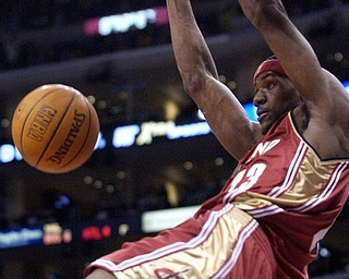 Cleveland Cavaliers' LeBron James dunks against the Los Angeles Clippers during the first half at Staples Center in Los Angeles, Wednesday, Dec. 3, 2003. (AP Photo/Chris Pizzello)