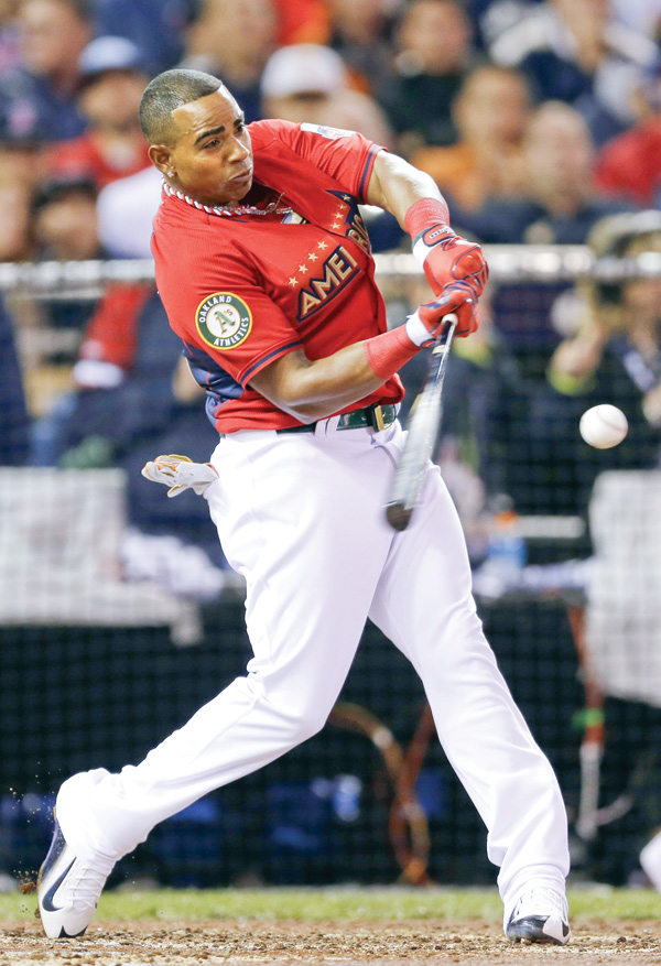 The American League's Yoenis Cespedes, of the Oakland Athletics, hit nine homers in the final round to win Monday's Home Run Derby at Target Field in Minneapolis.